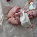 Wie eine Windel auf einem Baby tragen