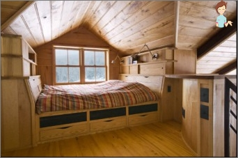The bedroom in the attic: attic possibility of allocating a room and creating an interior