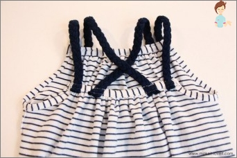We sew a beautiful dress for the girl